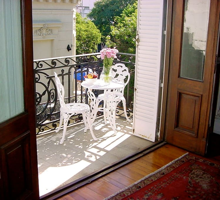 Cafe table on balcony facing the Plaza Dorrego