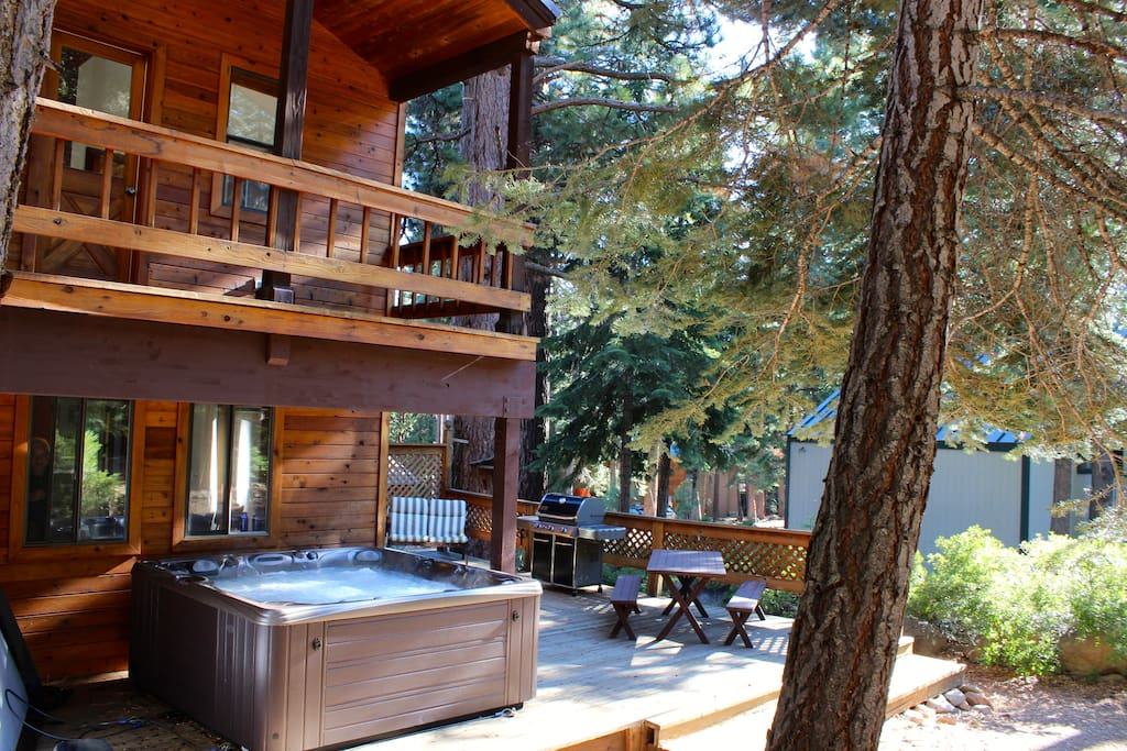 The back deck gets great afternoon sun!  Enjoy the horseshoe pit, picnic table, stainless steel Weber grill and the 6 person hot tub with 46 jets!