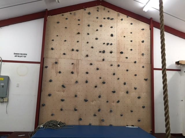 20+ foot climbing wall.  There are a few sizes for harnesses.  But there is a gymnastics mat to catch any falls.