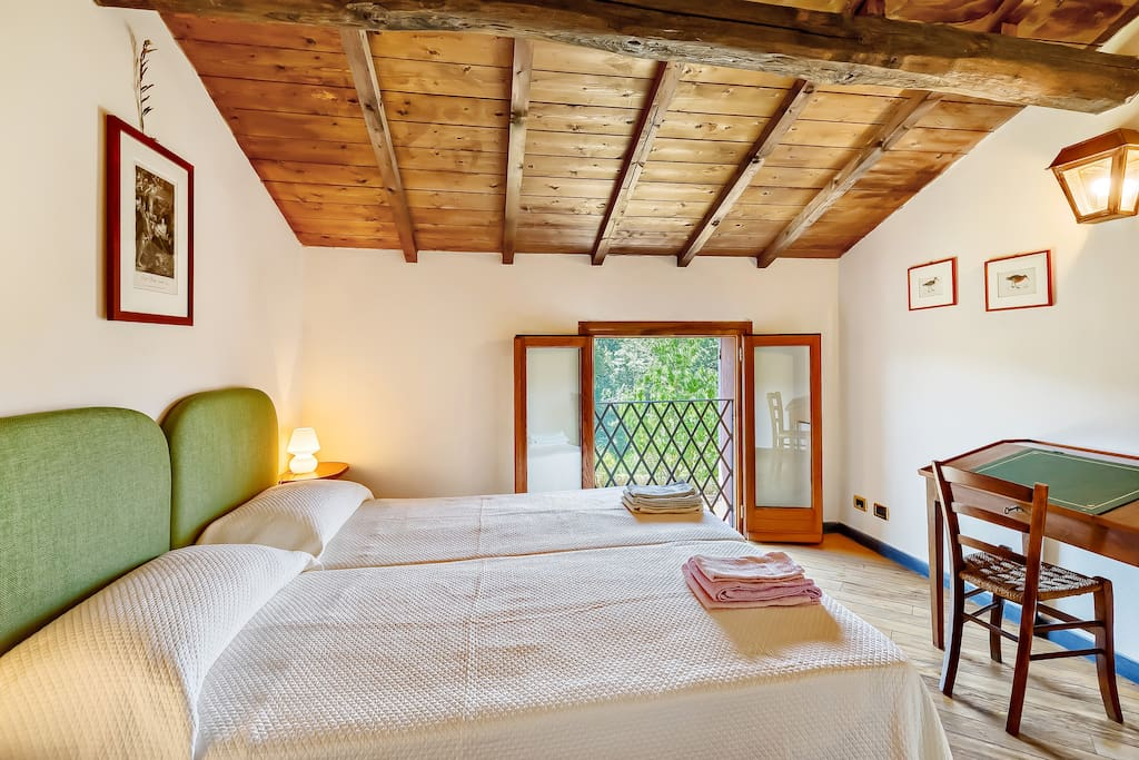 The Bedroom with the comfortable double bed with soft bed-linen and towels & the large window on the garden