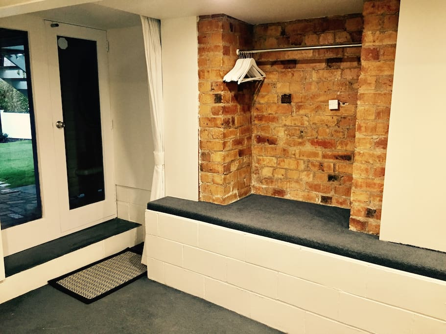 The private entrance to your room and large original brick wardrobe space