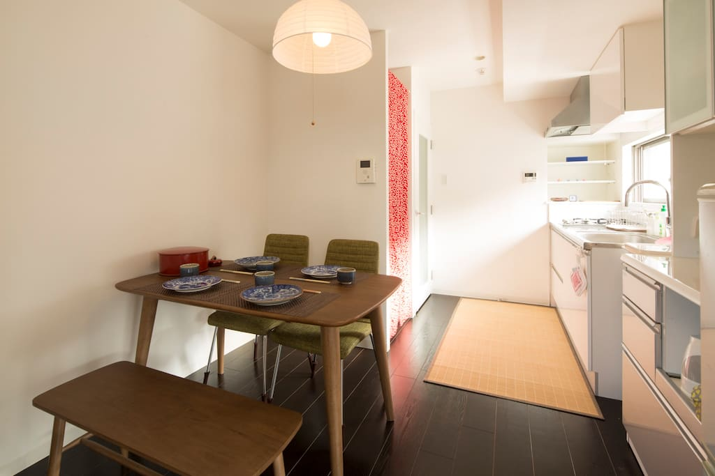 Airy dining room with washing machine and detergent for your laundry needs.