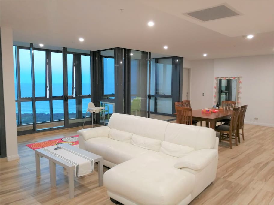 Living Room with amazing view of the Ocean, Marina and all the way to Moreton Island