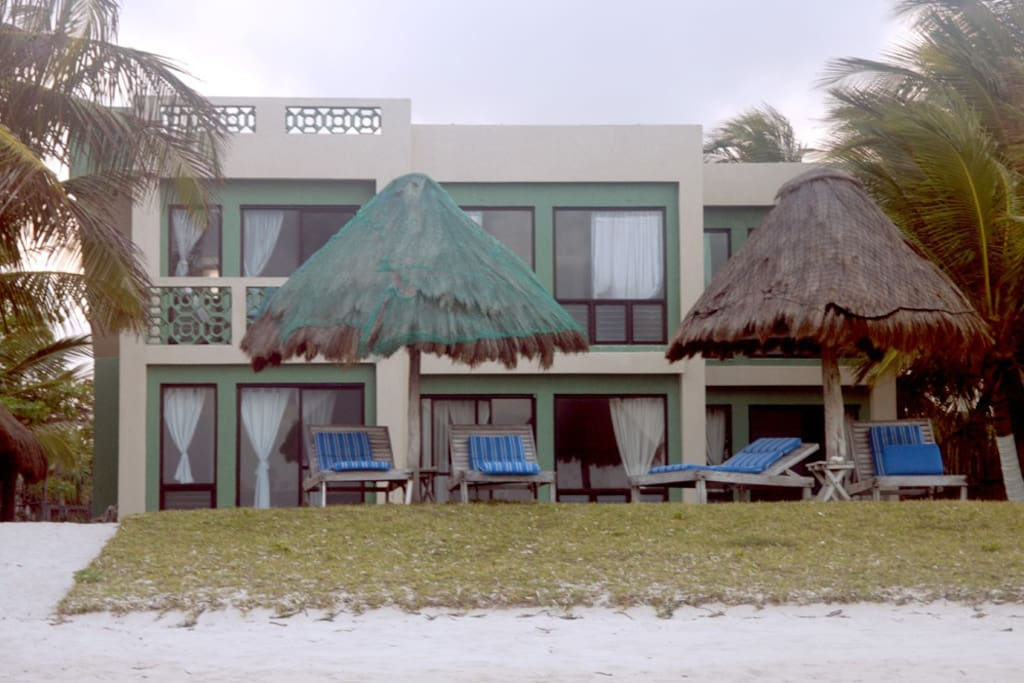 View from the beach looking west at Casa de Suenos. South unit is on the left side of lower level.