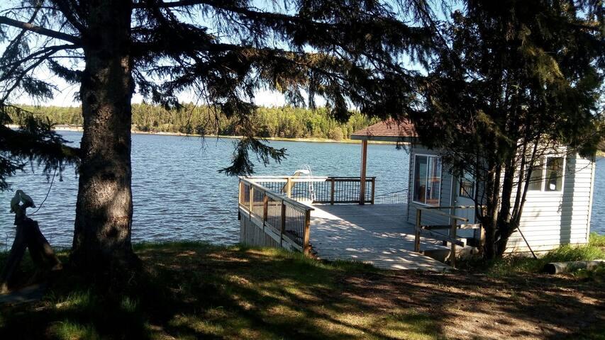 Cabin on Winnipeg River ~boatslip~