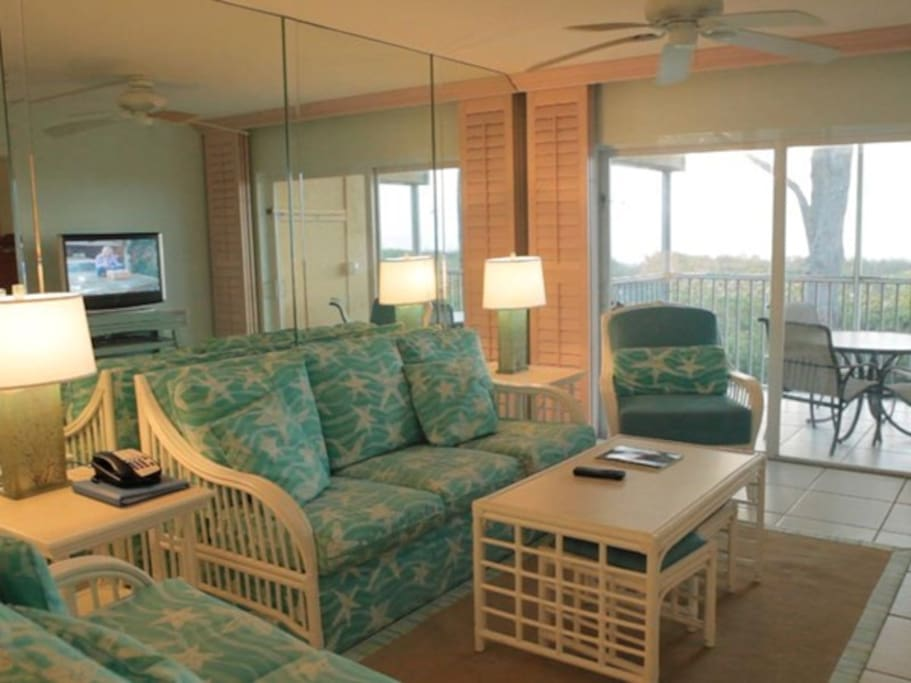 Living room and lanai with Gulf view