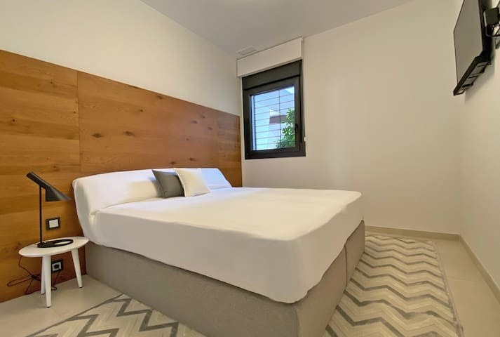 Your second bedroom with a modern smart television.