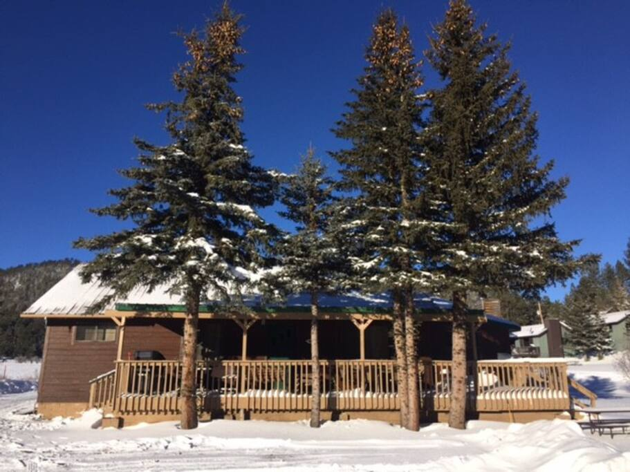 Blue skies, sun and snow! View of the cabin from Main Street.