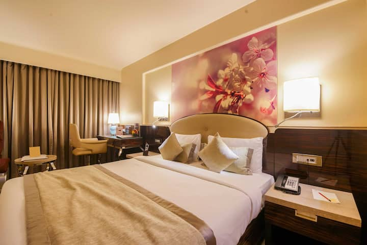 Executive room in a hotel at Malad West