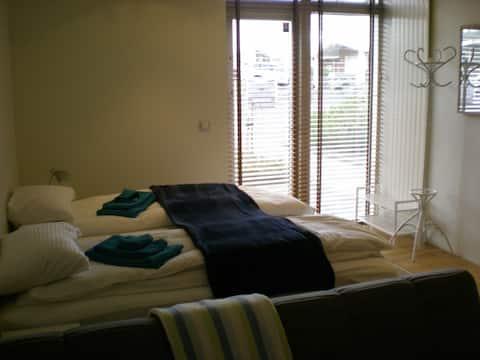 Bedroom from extra sofa towards entry