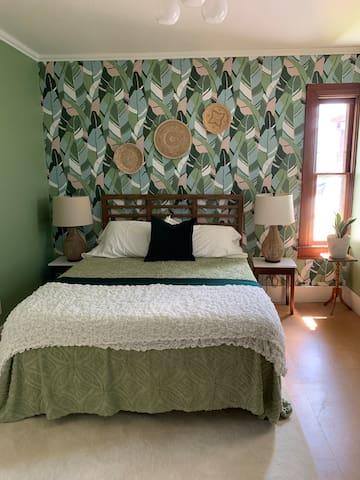 Queen memory foam bed in the bedroom.