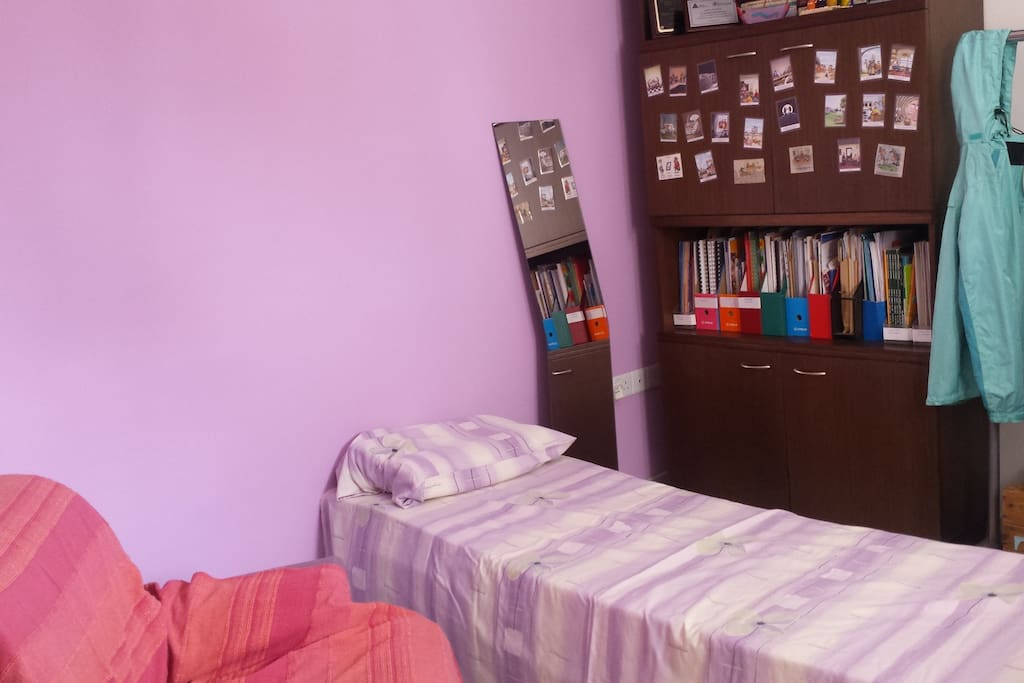 The available bedroom (with mirror) in natural light from the window. Blankets also available.