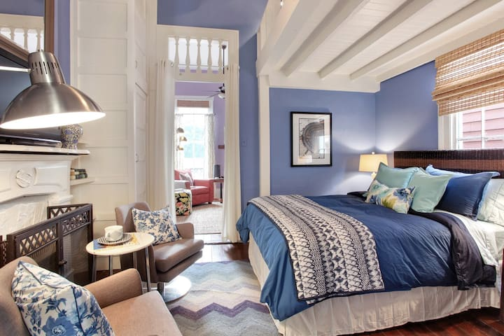 Two queen beds (bunk-bed style) are housed in he elegant bedroom, along with a SmartTv.