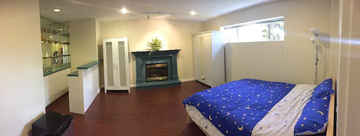 Large wood-floor room with private bathroom.