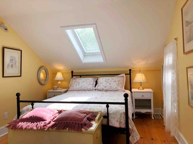 Upper level bedroom with two skylights.