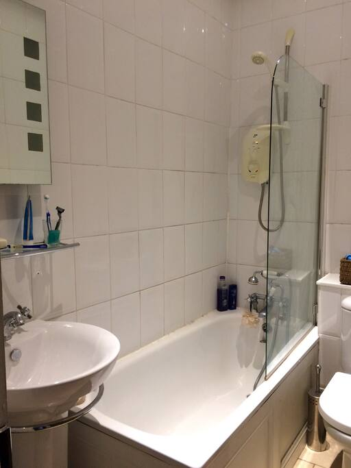 Shared family bathroom with electric shower