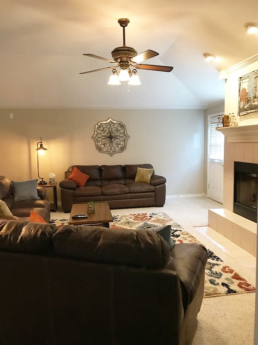 Upstairs living area has a natural gas fireplace and plenty of comfortable seating