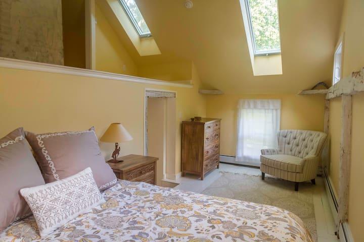 Queen bedroom with skylights and window AC on second floor