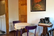 Table and chairs for desk or for eating. Coffee maker, toaster, electric kettle, microwave, hot plate.