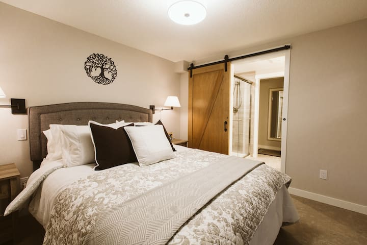 Bedroom - cozy queen bed - adjacent to private bathroom and large custom shower.