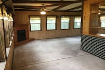 Three season family room with a gas fireplace.  Nice spacious area.