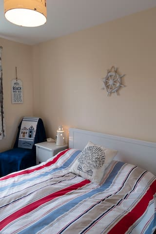 Lovely beach themed double room with chest of drawers, wardrobe and bedside cabinet. You can even see Edinburgh Castle way in the distance from your window!