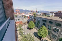 Property is on the edge of Gastown and Railtown in downtown Vancouver (next to the train tracks). It offers a small balcony with north east mountain and Railtown rooftop views.