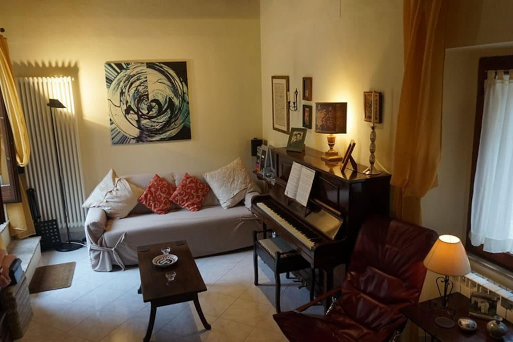 Living Room, sofa bed, coffee table and piano