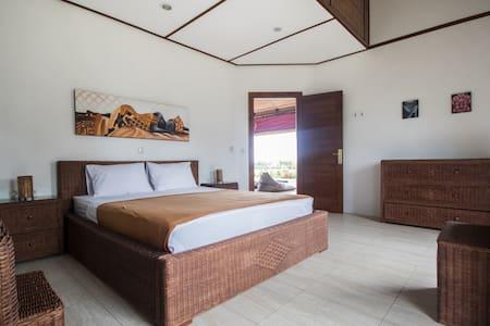 snaffl Beach Villa: chambre double du côté Ouest - Pekutatan - Villa