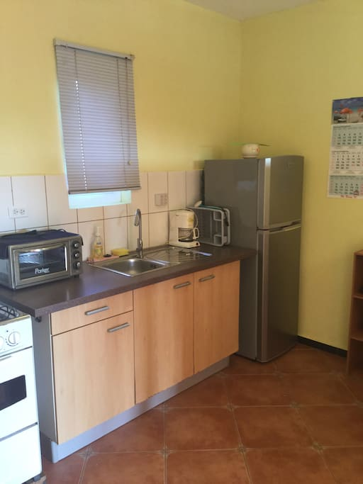 Kitchen with free use of washer