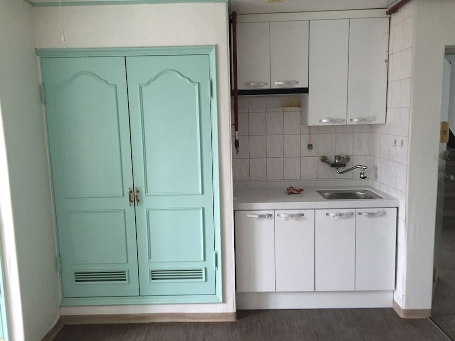 Closet and the mini kitchen. refreigelator is in behind
