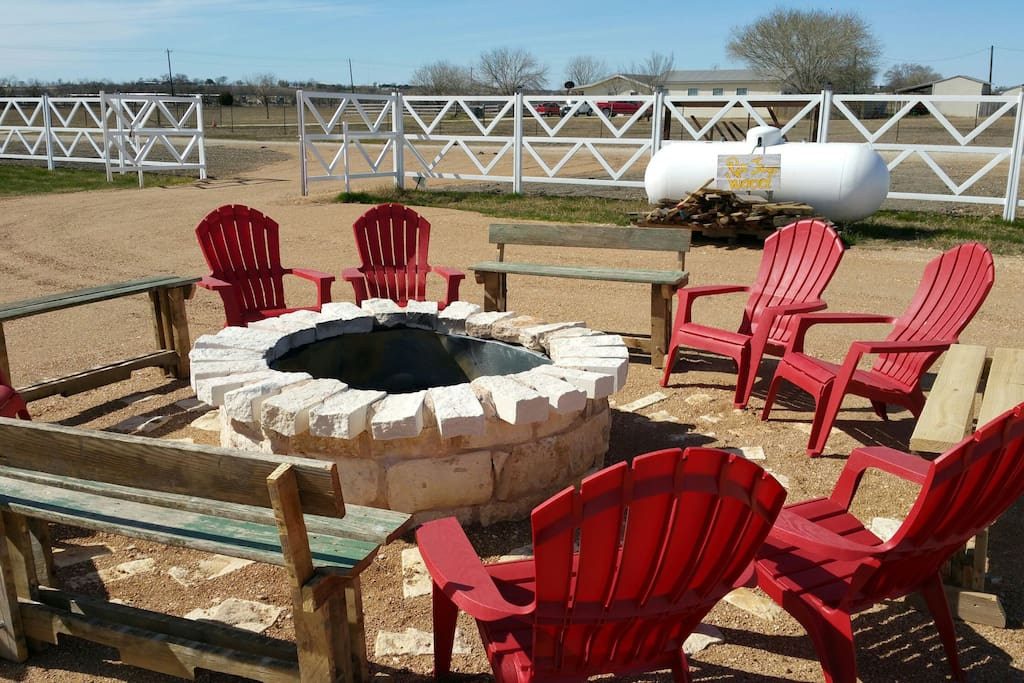 Big fire pit with a lot of seating for entertaining