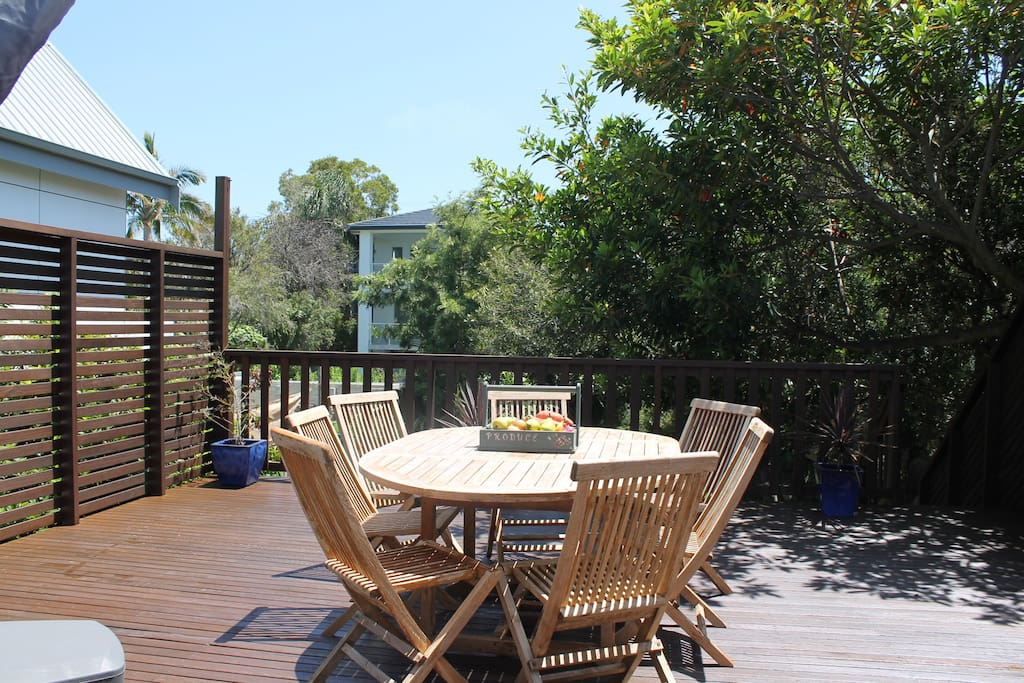 Top back deck with dining setting, BBQ and large canopy umbrella