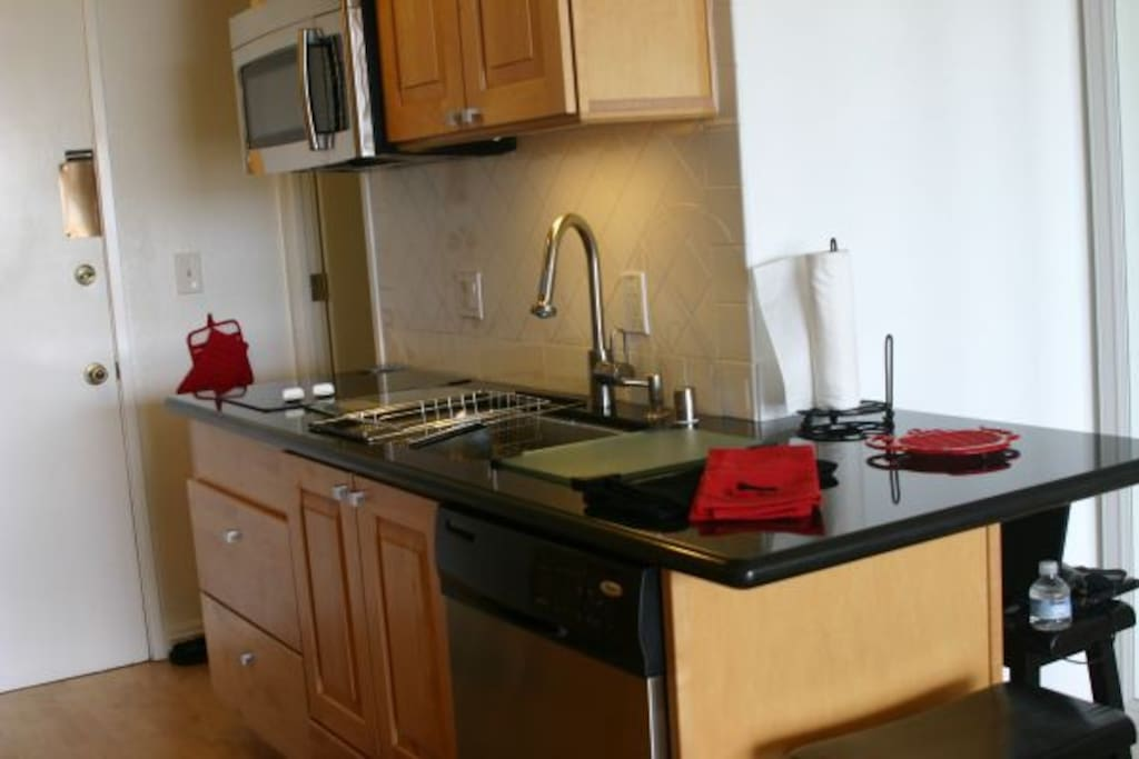 2 Glass Top Built in 2 Burners, and a Brand new Built-In LG SS  Microwave Oven with exhaust fan.