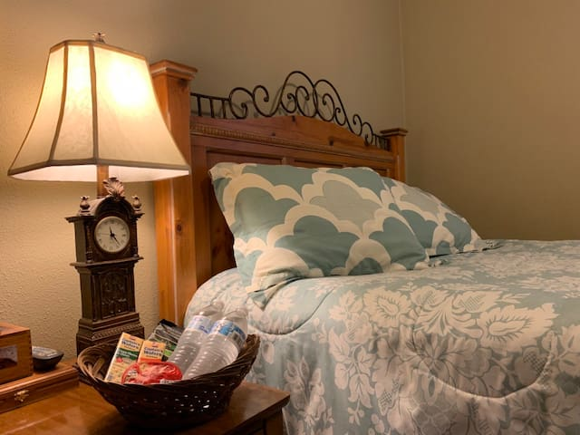 Your private bedroom with queen sized bed, soft sheets and four pillows.