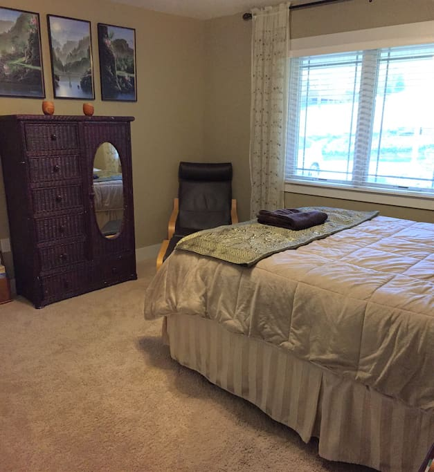 Your private room with queen size memory foam mattress, chair for reading, or relaxing, and book exchange.
