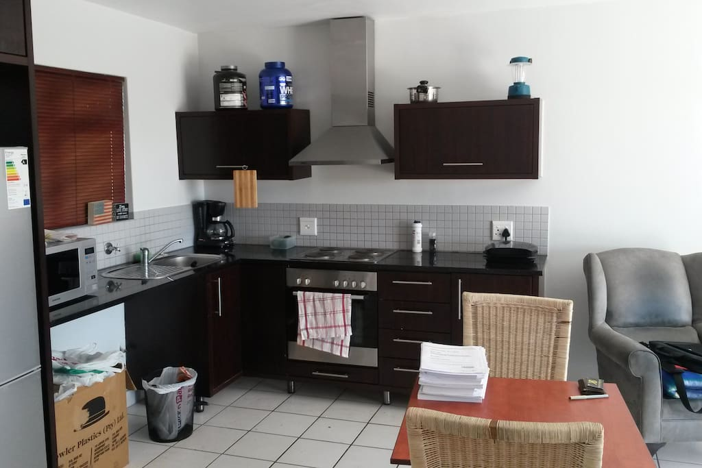 Full kitchen area with fridge, stove, oven, microwave