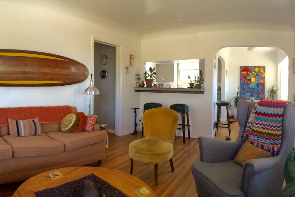 Living room facing south toward the kitchen and dining area. 180 degree of city from the couch.