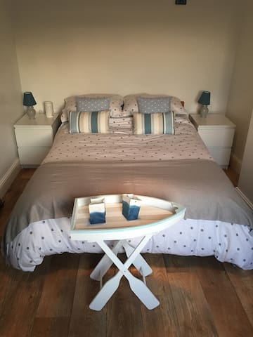 Lovely room in a home near the beach and bars