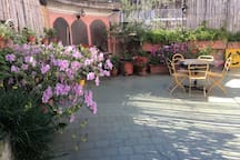 Huge and sunny terrace, where to have breakfast or relax after a day of walking the city! Practice yoga or study, as well...