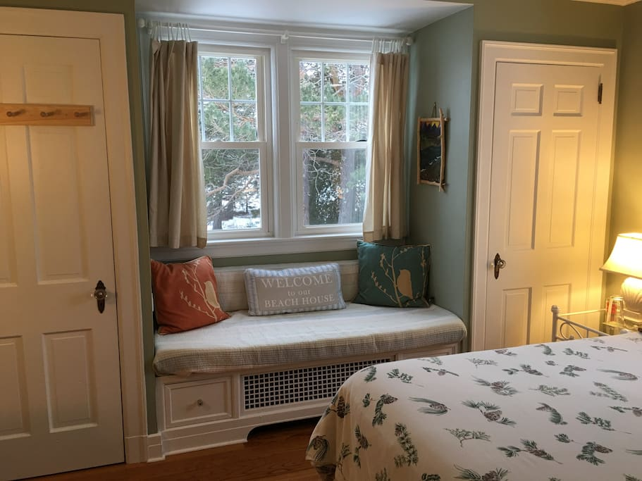 Cozy  west facing window seat over looking backyard, pine trees, bird feeders and setting sun.  Ample closet space.
