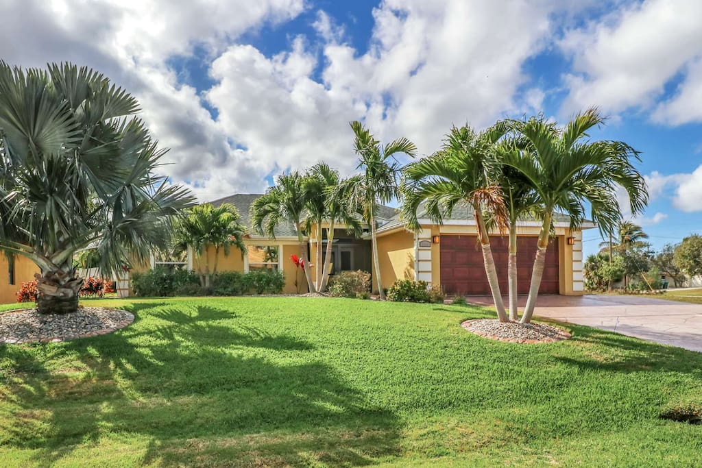 This stunning 4 bedrooom home epitomizes the southwest Florida lifestyle, surrounded by lush and tropical landscaping.