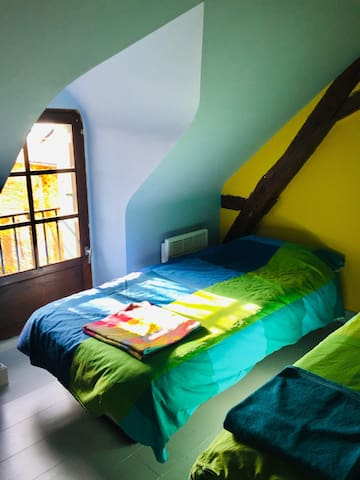 Two single beds with a drawer for clothes under the bed. Shutters in all rooms for afternoon naps.
