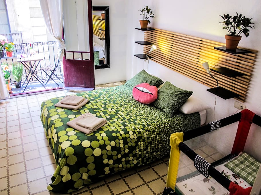 Bedroom 1, small balcony, babycot
