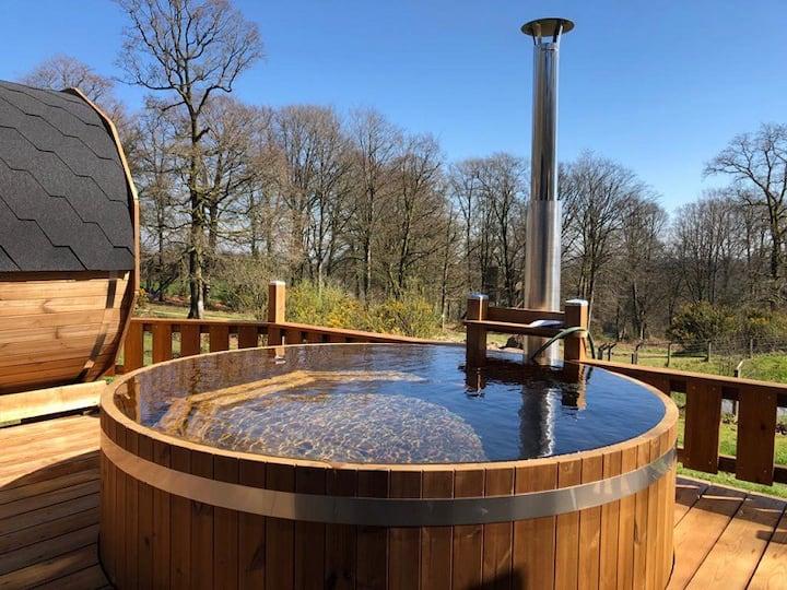 Cabane dans les arbres et bain nordique privatif