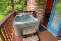 hot tub on side porch off living room