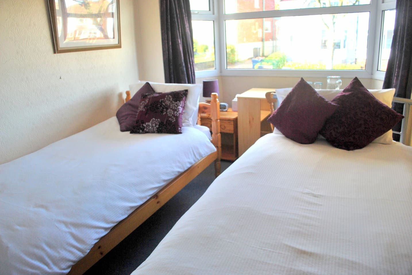 The room with twin beds and plump, cosy duvets