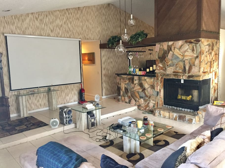 Great Room, 10' movie projection screen, wetbar, fireplace