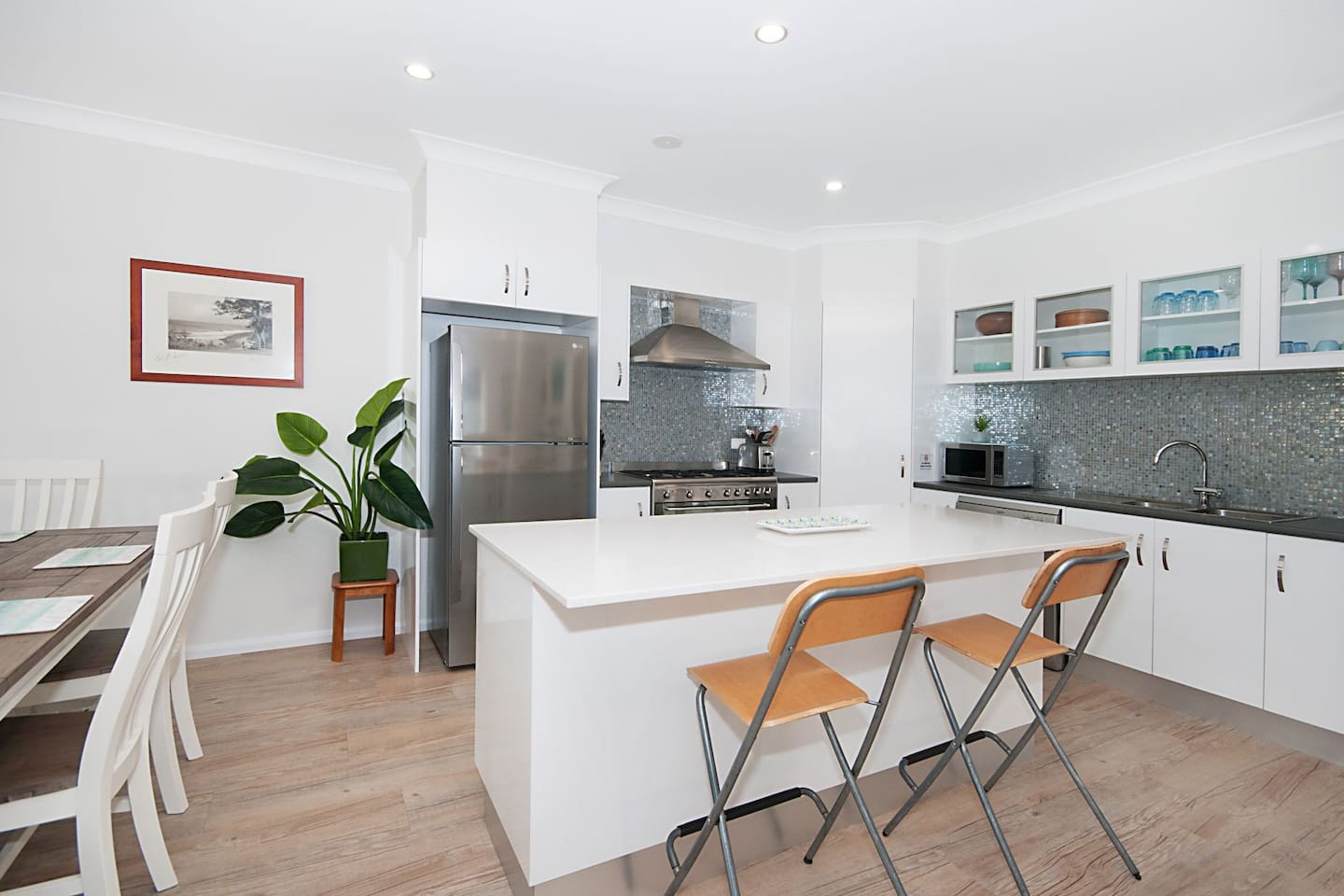 Kitchen. Oversize gas stove, SS appliances, stone bench top glass tiles. Fully equipped!