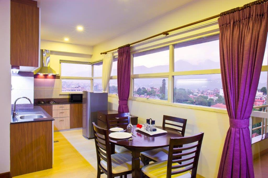 Dining and kitchen area is one bedroom suite